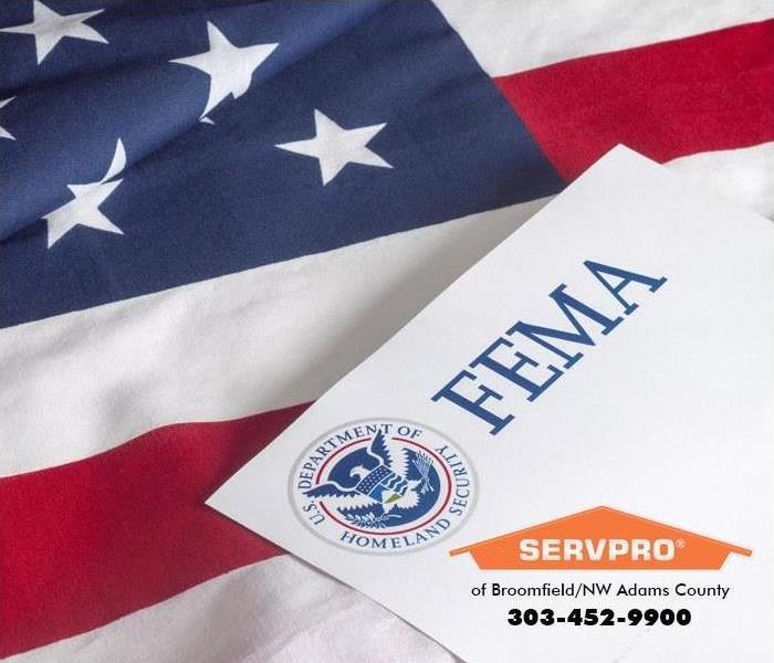 FEMA document laying on top of an American flag.